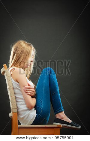 Young Sad Woman Sitting On Chair