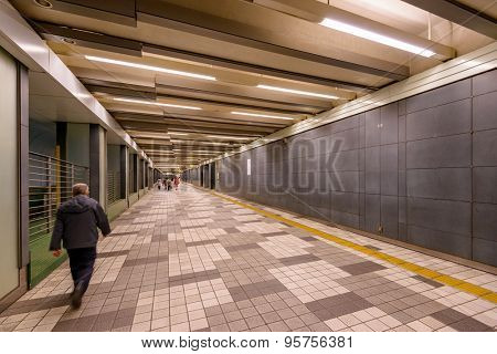 TOKYO, JAPAN - JANUARY 1, 2013: Pedestrians use the underground walkways in Shinjuku. The passages lead to and from Shinjuku Station.