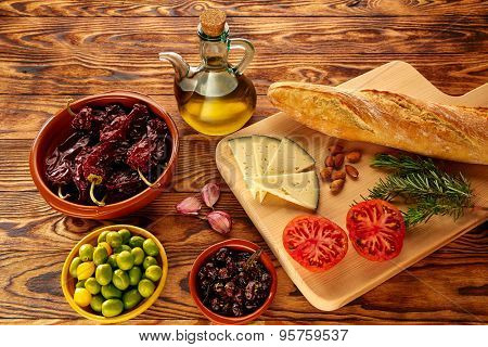 Mediterranean food bread oil olives cheese peppers garlic almonds rosemary