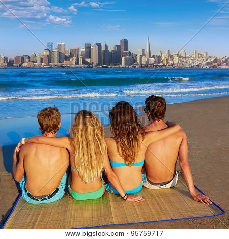 friends group couples sitting in beach sand rear view San Francisco skyline photo mount