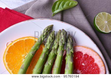 Fresh asparagus on plate, close-up