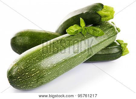 Fresh zucchini with basil isolated on white