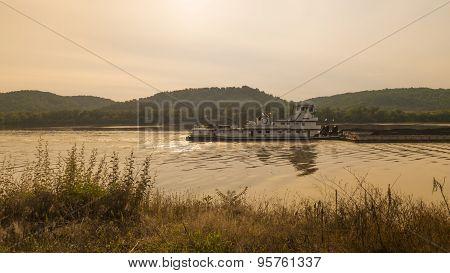 Coal Barge on a River. Warm Summer Amber Golden Light.