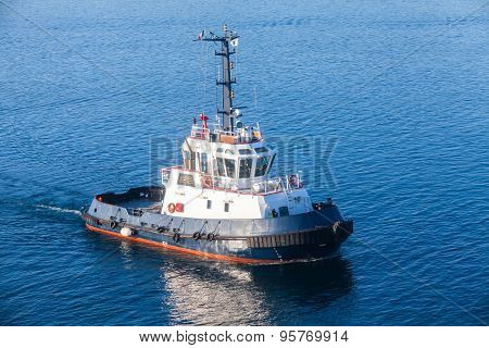 Tug Boat Underway On Sea Water