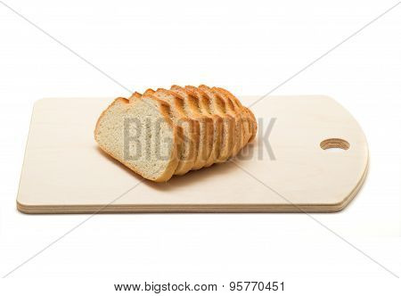 Sliced Loaf On A Wooden Chopping Board