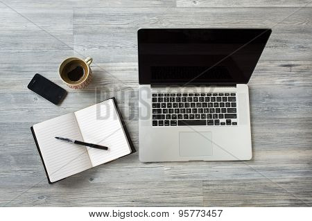 Unique Perspectives Of A Business Table With An Agenda, Laptop, Smart Phone, Coffee