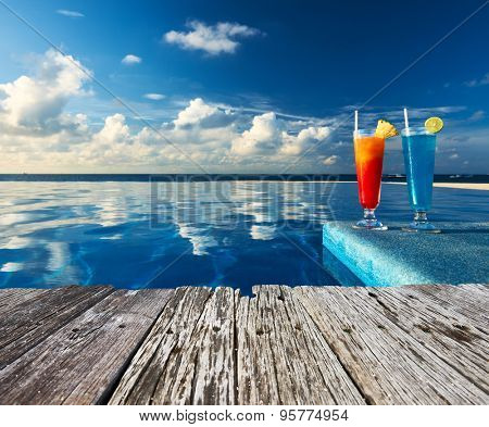 Cocktails near the swimming pool and old wooden pier