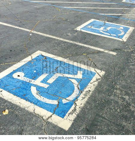 Handicapped symbols painted on parking spaces