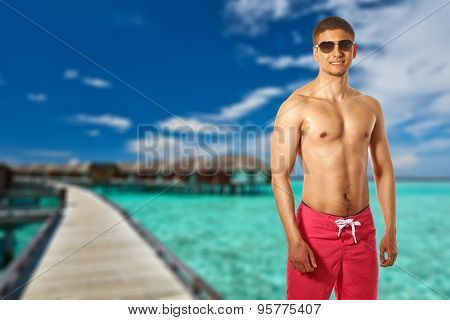 Man on beach with water bungalows at Maldives. Collage.