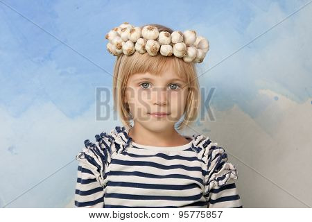 Little Girl With Garlic Wreath On Her Head