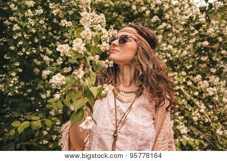 Bohemian Young Woman Enjoying Flowers Fragrance