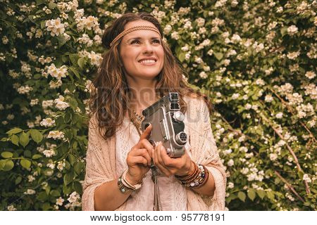 Bohemian Young Woman With Retro Camera Looking Up On Copy Space