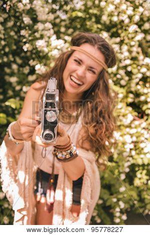 Closeup On Bohemian Young Woman Among Flowers Using Retro Camera
