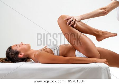 Physiotherapist Doing Healing Massage On Female Legs.