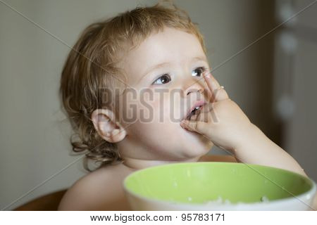 Portrait Of Beautiful Baby Boy Eating