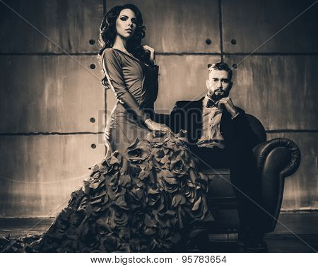 Young elegant couple in evening dress portrait. Retro film style colors.