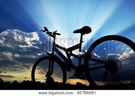 backlit bicycle and blue sky sunlight in evening