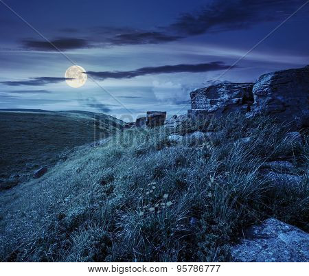 Boulders On Hillside In High Mountains At Night