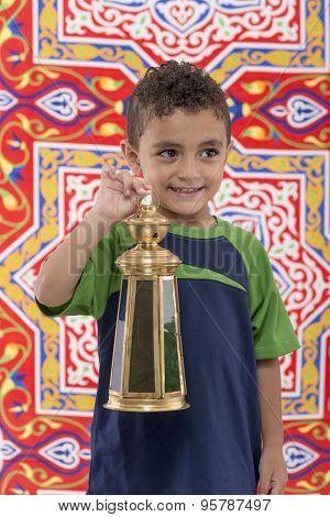Adorable Young Boy With Ramadan Lantern Looking Away