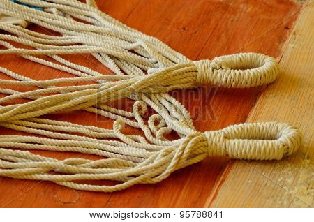 Ropes with loops on brown background