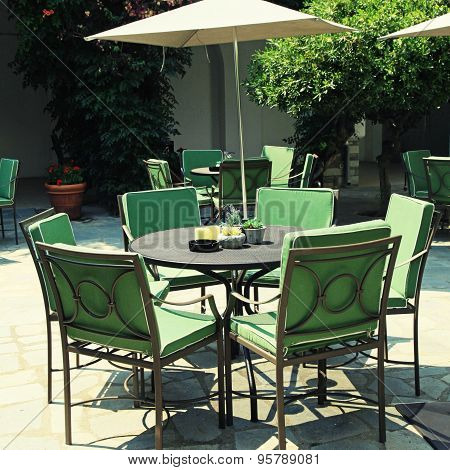 Iron Tables And Chairs In Beautiful Patio