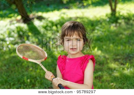 Girl With A Badminton Racket Summer Day
