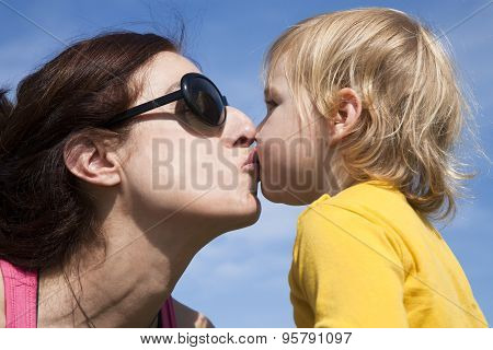Baby And Mom Kissing