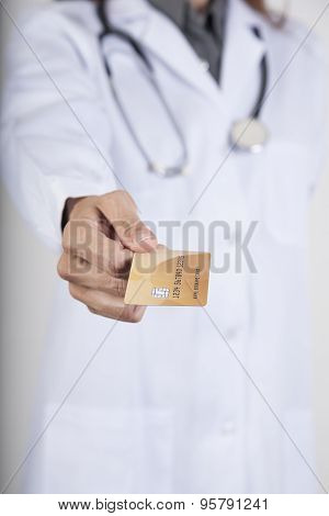 Doctor Offering Credit Card