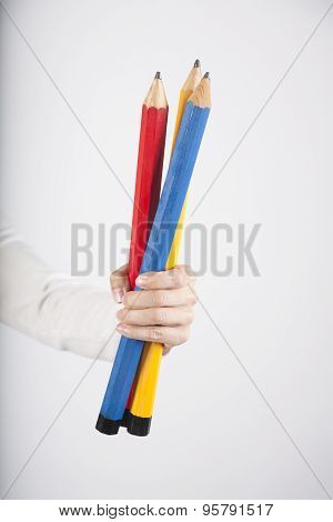 Three Big Pencils In Hand
