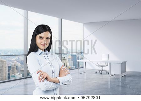 A Brunette Business Woman In A Workplace At Modern Corner Panoramic Office In New York, Manhattan. A