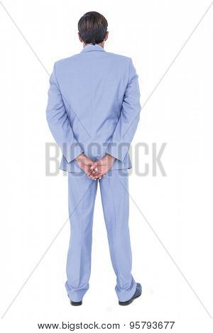 A back turned businessman on a white background