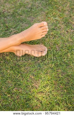 Barefoot in the grass on a sunny day