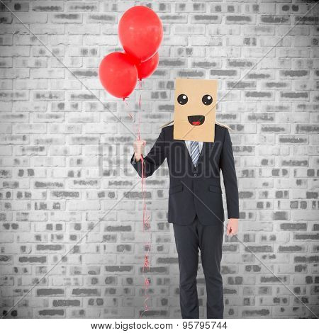 Anonymous businessman against grey brick wall