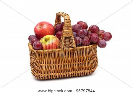Ripe Grapes And Apples In The Basket On A White Background