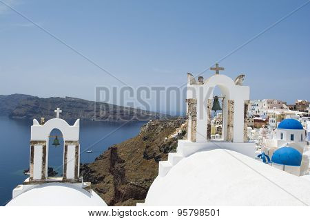 Two bell towers  in Oia village, Santorini island