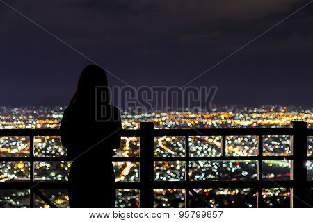 Blurred Girl And City Light From Viewpoint