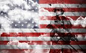 pic of rifle  - soldier with rifle on a usa flag background double exposure - JPG