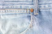stock photo of denim jeans  - the Worn blue denim jeans texture background - JPG
