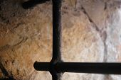 foto of scabs  - Image of rigid metal bars of a country house - JPG