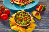 stock photo of nachos  - Guacamole with avocado tomatoes and nachos mexican food - JPG