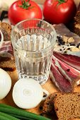 stock photo of vodka  - Vodka and smoked meat on wooden table - JPG