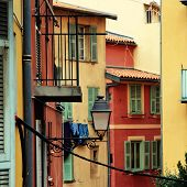 picture of nice house  - Multicolored houses with green shutters in the old town of Nice - JPG