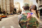 picture of reunited  - Father reunited with daughter against new york street - JPG