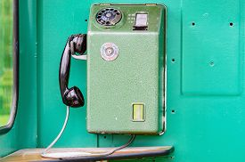 stock photo of phone-booth  - An old telephone from inside a telephone booth from the 1970s - JPG
