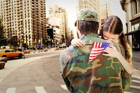 foto of reunited  - Father reunited with daughter against new york street - JPG