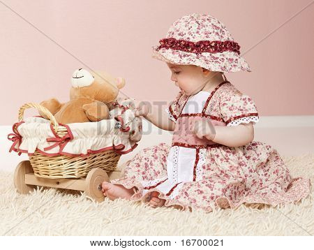 little child baby plying with toys