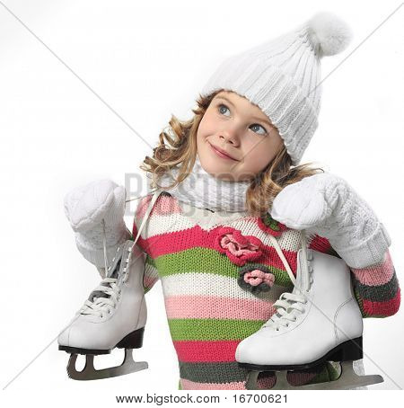 cute little girl in warm hat and gloves with figure skates on white background