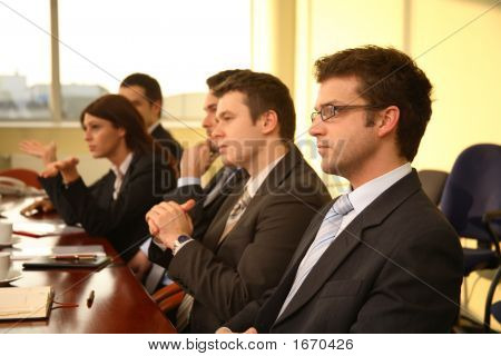 Five Business Persons At A Conference,Interview