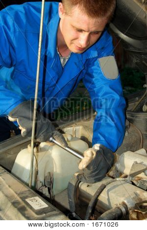 Auto Mechanic Working