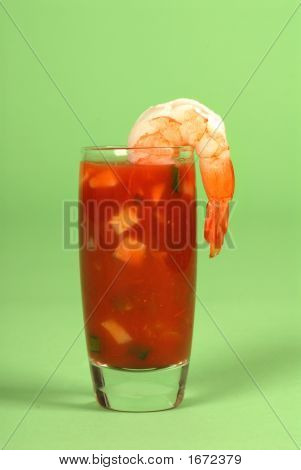 Vertical View Of A Shrimp On A Glass Containing A Salsa Cocktail Sauce
